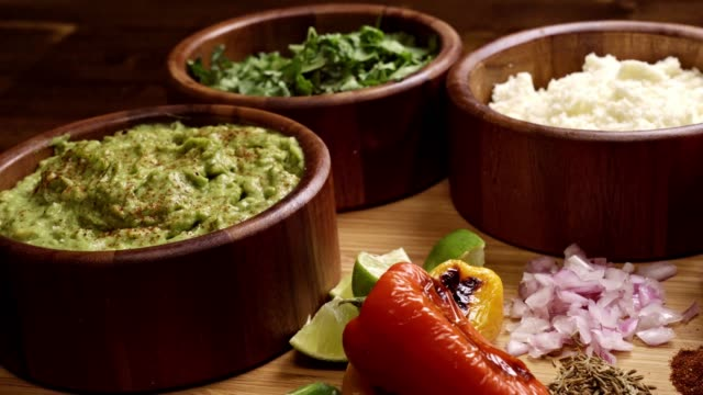vídeos de stock e filmes b-roll de mexican food ingredients including guacomole, cilantro and cotija cheese - modo de preparação de comida