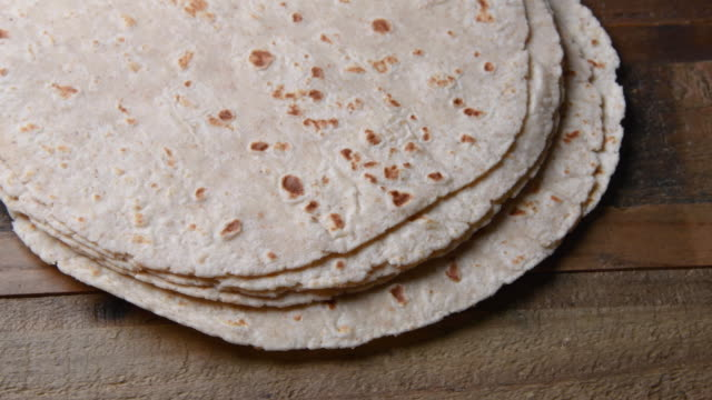 mexican home made flour tortillas from above - tortilla flatbread stock videos & royalty-free footage