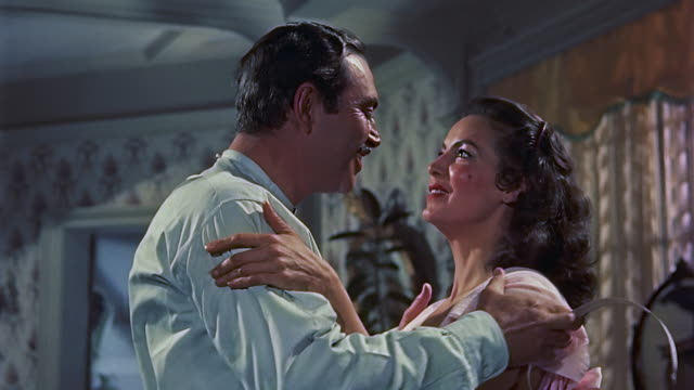mexican icon maria felix waked up from bed walks to the balcony opens the window and stretches then actor pedro armendariz comes in she fixes his... - pyjamas stock videos & royalty-free footage