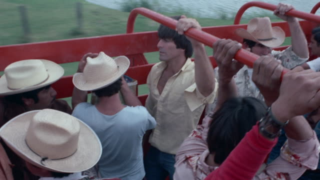 mexican immigrants are ready to cross the border on a red truck. dramatization. - mexican ethnicity stock videos & royalty-free footage