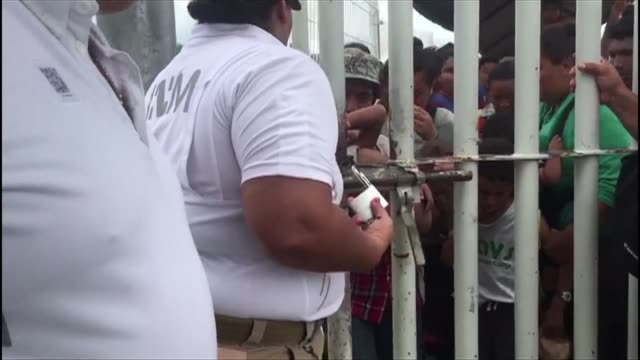 Mexican immigration officials re open the gate on the Mexico Guatemala border bridge letting through a handful of immigrants but thousands more wait...