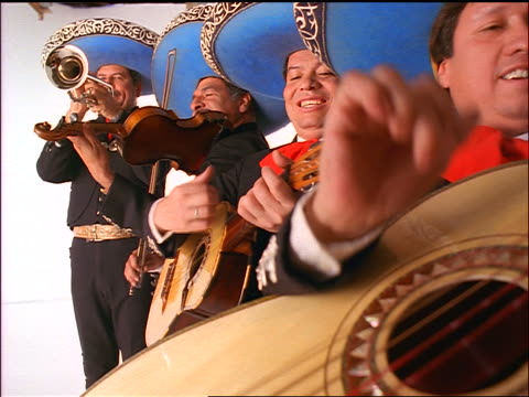 mexican mariachi band playing instruments + wearing blue sombreros - mexican ethnicity stock videos & royalty-free footage