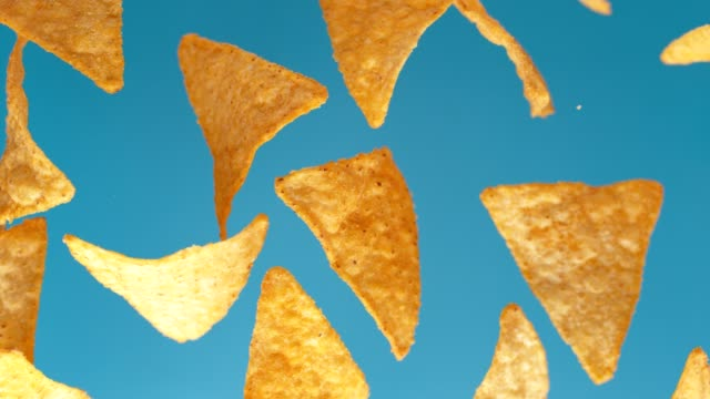 vídeos de stock e filmes b-roll de mexican nachos chips beauty shot. - ingrediente
