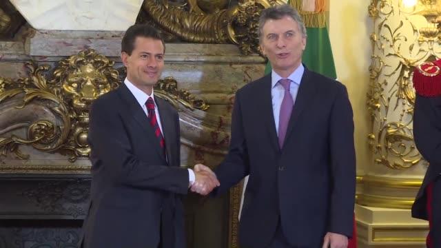 Mexican president Enrique Pena Nieto meets with his Argentine counterpart Mauricio Macri Friday in Buenos Aires at the Casa Rosada while dozens...