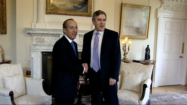 Mexican President Felipe Calderon and Gordon Brown photocall ENGLAND London Downing Street INT Gordon Brown MP into room with Mexican President...