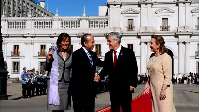 Mexican President Felipe Calderon was welcomed by is Chilean counterpart Sebastina Pinera at the La Moneda presidential palace in Santiago during his...