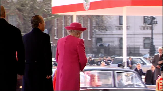 Mexican President visit to Britain / ceremony at Horseguards Parade Felipe Calderon out of car onto podium and shakes hands with Queen and Prince...