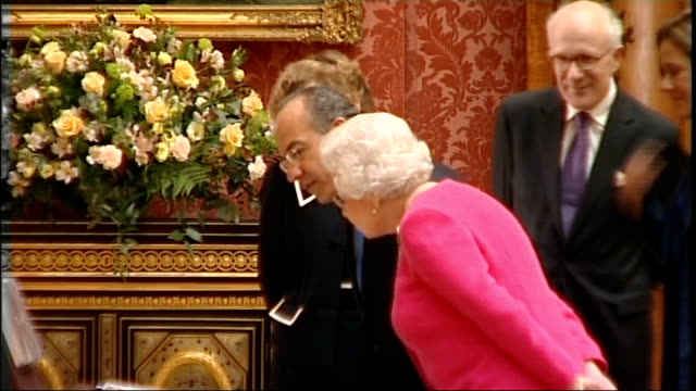 Queen showing Picture Gallery exhibition *** FLASH Queen Elizabeth II and Felipe Calderon entering room followed by Prince Philip and Margarita...