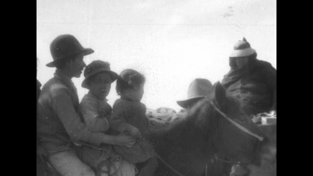 mexican refugees riding in wagons pulled by horses rolling down road / closer shot of four refugee children sitting on horse / refuges standing... - military camp stock videos & royalty-free footage