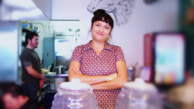 mexican restaurant proprietor posing in kitchen - mexican restaurant stock videos & royalty-free footage