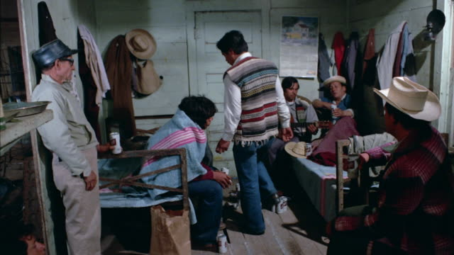 mexican sharing a small room. some of them are in bed. they are singing a sad song and playing the guitar. dramatization. - domestic room stock videos & royalty-free footage