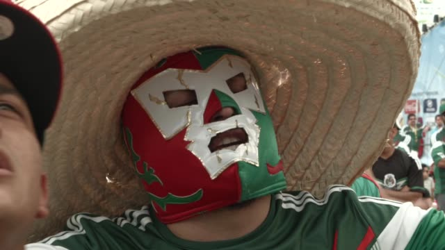 ecu mexican soccer team fans react as they watch their team beat the cameroon team while watching the game on the giant screen showing the match at... - sombrero stock videos & royalty-free footage