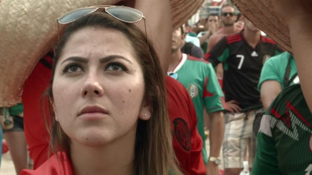 CU Mexican soccer team fans react as they watch their team beat the Cameroon team while watching the game on the giant screen showing the match at...
