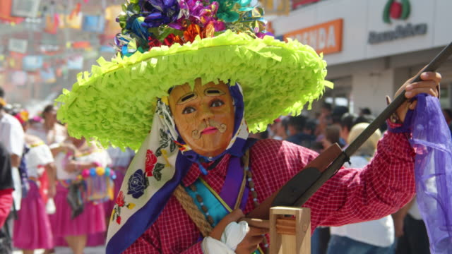mexican traditional costume with a shotgun. zoque coiteco carnival parade at chiapas, mexico village. mexican syncretism tradition - papier stock videos & royalty-free footage