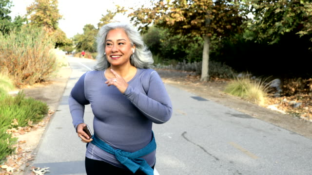 mexican woman jogging - overweight active stock videos & royalty-free footage