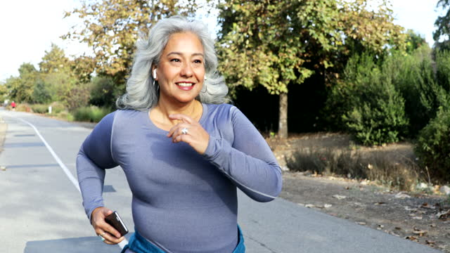 mexican woman jogging - grey hair stock videos & royalty-free footage