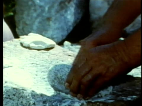1963 REENACTMENT PAN CU ZO MS Mexican woman making tortillas outdoors / 1820s Texas / AUDIO