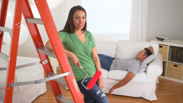 mexican woman unhappy with lazy boyfriend - ladder stock videos & royalty-free footage