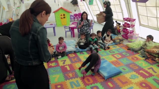 mexicanlebanese artist salma hayek visits syrian refugees at saad nayel refugee camp in bekaa valley and play games with syrian children in beirut... - salma hayek stock videos and b-roll footage