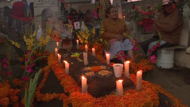 mexicans create elaborate altars for their late family members decorating them with flowers colorful paper cutouts and things the person loved as... - altar stock videos & royalty-free footage