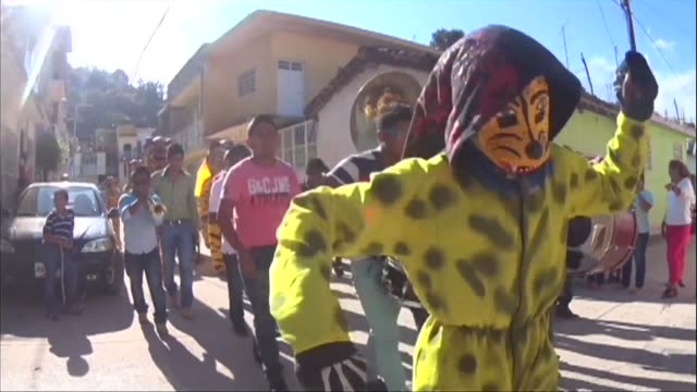 mexicans defy fears of a drug cartel attack in the town of tigrada going ahead to hold the annual ancient festival of the tiger after a gang of 300... - drug cartel stock videos and b-roll footage