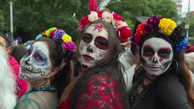 Mexicans dress up as Catrina a Mexican representation of death and take part in a parade ahead of the Day of the Dead celebrations