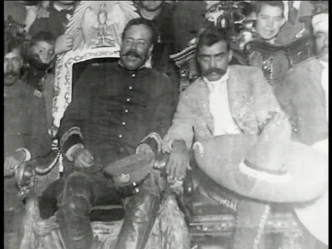 mexicans looking at pictures on wall. photo of governor pancho villa sitting w/ emiliano zapata. photo of president venustiano carranza. photo of... - mexikanischer abstammung stock-videos und b-roll-filmmaterial
