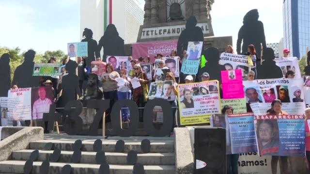 mexicans protest with portraits of their missing relatives on the international day of the disappeared denouncing the inaction of the government in a... - trafficking stock videos & royalty-free footage