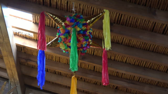 mexico a pinata hangs from a ceiling - papier stock videos & royalty-free footage