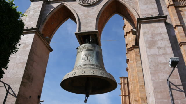 mexico arandas large bell hanging.mov - bell stock videos & royalty-free footage
