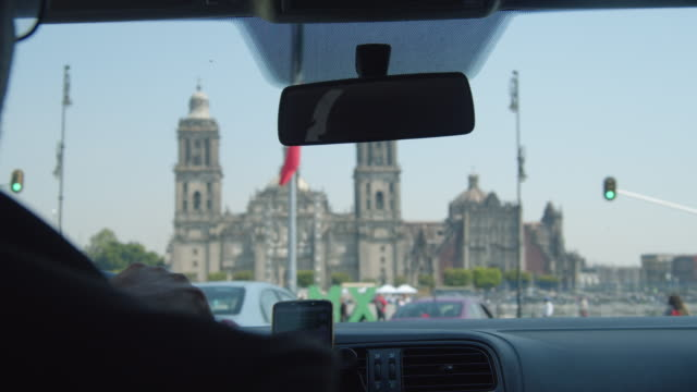 mexico city cathedral and mexican flag by car pov - road map stock videos & royalty-free footage