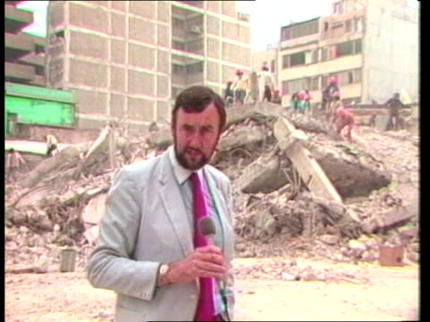 c mexico mexico city romano hotel well that's student teachers la man using pneumatic drill on rubble pull out ms rescue workers standing at bottom... - 1985 stock-videos und b-roll-filmmaterial