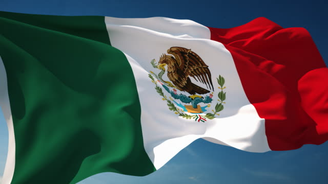 4k mexico flag - loopable - mexico stock videos & royalty-free footage