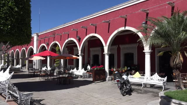mexico san julian arches and motor bike - pavement cafe stock videos & royalty-free footage