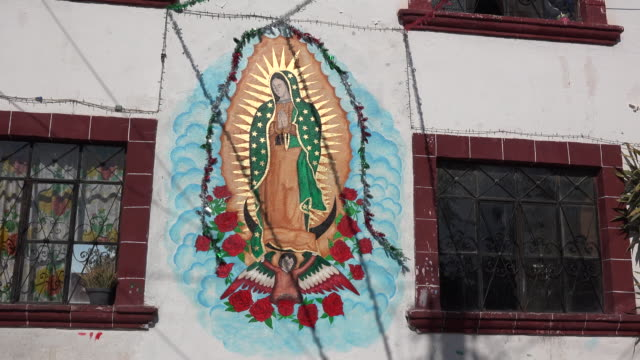 Mexico San Miguel de Allende Virgin of Guadalupe on house wall.mov