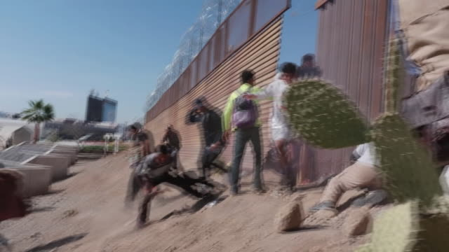 mexico says it will deport around 500 migrants who have tried to 'violently' and 'illegally' cross the u.s. border. it comes as the u.s. border... - border stock videos & royalty-free footage