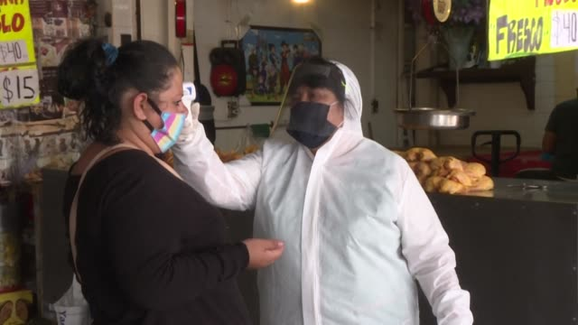 mexico's main wholesale, the central de abastos, works tirelessly to prevent the spread of covid-19, with workers checking customers' temperatures,... - central de abastos stock videos & royalty-free footage