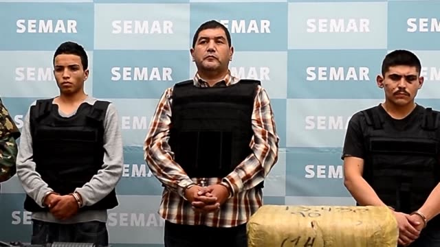 mexicos navy hauled a suspected leader of the brutal zetas drug cartel before news cameras thursday after catching the capo ivan velazquez caballero... - drug cartel stock videos and b-roll footage