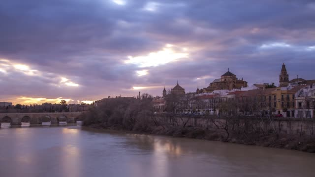 t/l mezquita de córdoba and guadalquivir river sunset - mesquita stock videos & royalty-free footage