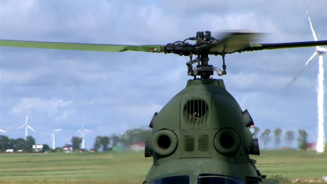 Mi-2 Helicopter Rotor at work against wind turbines