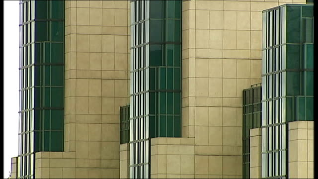 mi6 allegedly assisted in rendition of gaddafi opponents; lib vauxhall: union jack flag flying outside mi6 building windows of mi6 building general... - mi6 stock-videos und b-roll-filmmaterial