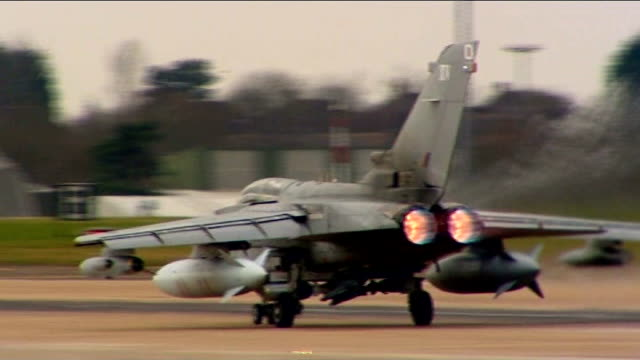 Mi6 allegedly assisted in rendition of Gaddafi opponents T21031107 Norfolk RAF Mareham DAY Back view of Tornado jet taxiing along runway