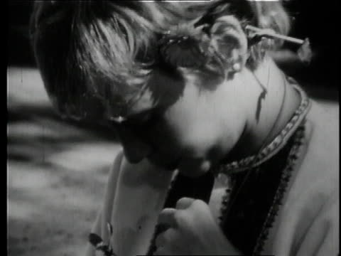 mia farrow putting flowers behind her ear and in her shirt / uttar pradesh india - mia farrow stock videos & royalty-free footage