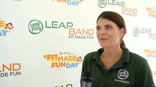interview mia hamm on why she endorses the leap band on her favorite feature on what she does to motivate her kids on what this day is about on why... - leapfrog stock videos & royalty-free footage