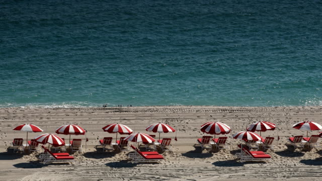 miami beach lounge chairs - chair stock videos & royalty-free footage
