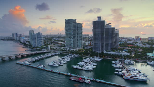 aerial miami beach marina in the government cut, miami, fl at dawn - 30 seconds or greater stock videos & royalty-free footage