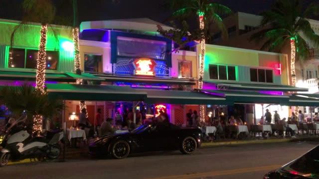 miami beach restaurants at night - boulevard stock videos & royalty-free footage