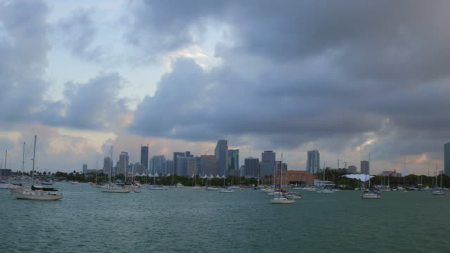 miami city skyline in the dusk afternoon time, view from tourist boat in the biscayne bay, florida, united states. - biscayne bay stock videos and b-roll footage