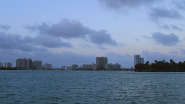 miami city skyline in the dusk afternoon time, view from tourist boat in the biscayne bay, florida, united states. - biscayne bay bildbanksvideor och videomaterial från bakom kulisserna