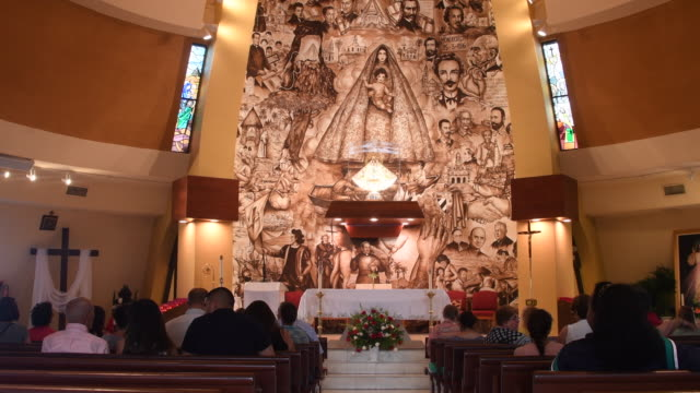 Miami, Florida: Our Lady of Charity sanctuary, chapel or shrine. Indoors image of altar and ambience. The Catholic landmark in a vital religious place in the Cuban culture